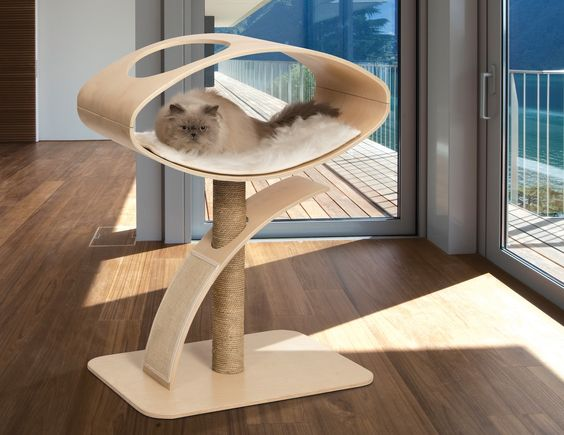 74785d72919b This modern-looking cat tree offers ample opportunities for feline  a-mews-ments like scratching, climbing and perching. (Doesn't that cat look  cozy?)